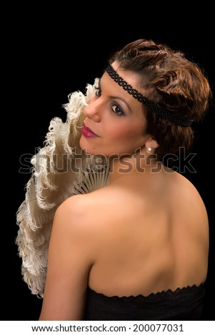 Glamour style vintage 1920 actress posing like a diva - stock photo