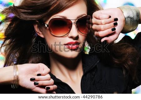 Glamour stylish beautiful  woman with fashion sunglasses and black manicure - stock photo