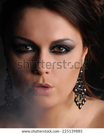 Glamour woman and cigarette smoke