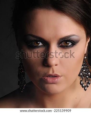 Glamour woman and cigarette smoke - stock photo