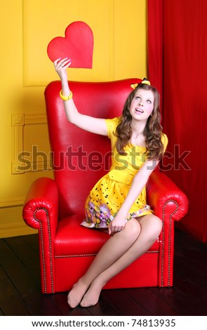 Glamour woman doll with heart - stock photo