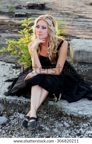 Glamour woman in black ballerina dress outdoor looking aside - stock photo