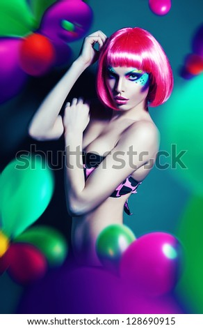 glamour woman in pink wig with balloons - stock photo