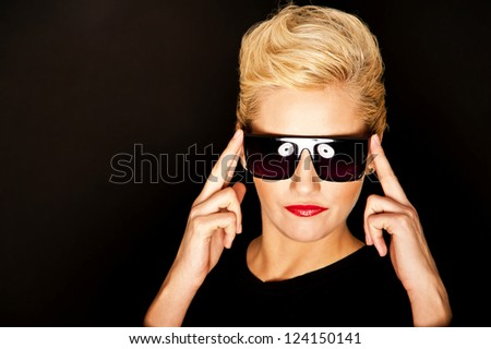 Glamour woman on gold background with sunglasses