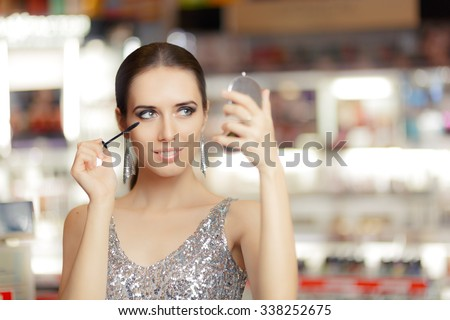 Glamour Woman with Mascara and Make-up mirror - Cool girl holding a mirror and getting ready for a party  - stock photo