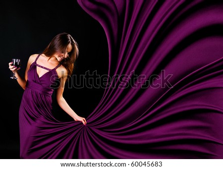 Glamour women with the whine on black background - stock photo