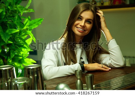Glamour young brunette woman with green eyes and charming smile looking at the camera - stock photo