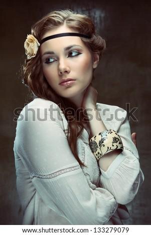 Glamourous hippie girl posing on grunge background, studio shot - stock photo