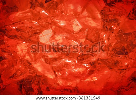 Glare glisten flame coquelicot rose color sulphate birthstone stack, mysterious lit by vivid hot carnelian coral glow. Close-up view with space for text on romantic refraction sparkle particle heap - stock photo