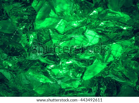 Glare sharp birthstone stack glisten depth fond of shiny vibrant dense irish mint malachite color lit by jade bio vert glow. Closeup view with space for text on ice refraction sparkle carbon ore heap - stock photo