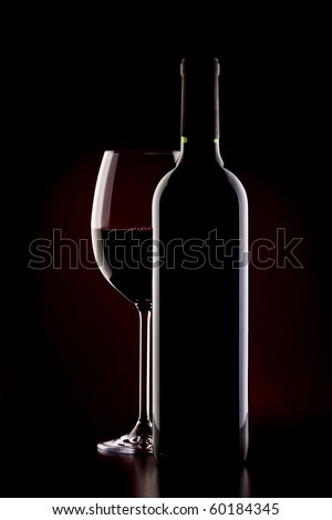 glas of red wine and bottle - stock photo