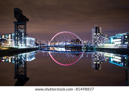 Glasgow Arc Bridge illuminated pink - stock photo