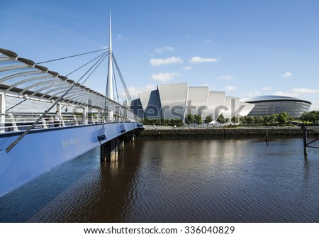 GLASGOW, SCOTLAND - JUNE 05, 2014: Bells Bridge, The Armadillo Clyde Auditorium and The Hydro.The bridge was built to allow pedestrians easy access to the Exhibition centres from across the Clyde. - stock photo