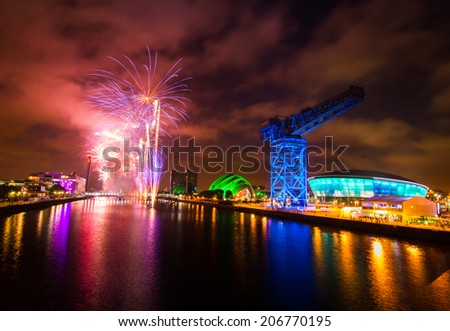 GLASGOW, SCOTLAND, UK - JULY 23, 2014: Fireworks over River Cycle, Opening Ceremony Commonwealth Games 2014, Glasgow Scotland, 23rd July 2014 - stock photo