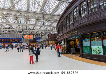 Glasgow, UK - September 12, 2016: inside the central station in Glasgow with unidentified people. Glasgow Central is the major mainline rail terminus, opened by the Caledonian Railway on 31 July 1879