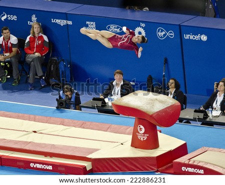 GLASGOW, UNITED KINGDOM - JULY 30: gymnast Claudia Fragapane on Vault in Ladies All Around A Final at Commonwealth Games in SSE Hydro on July 30, 2014 in Glasgow, United Kingdom. Fragapane won gold. - stock photo