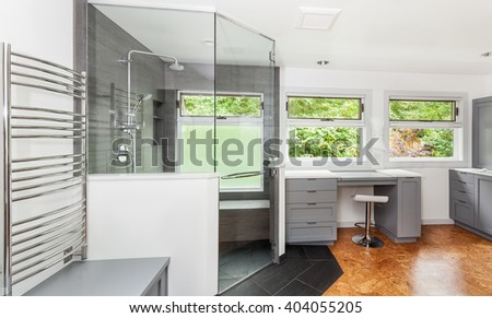 Glass above pony wall and full height door with towel bar installed - stock photo