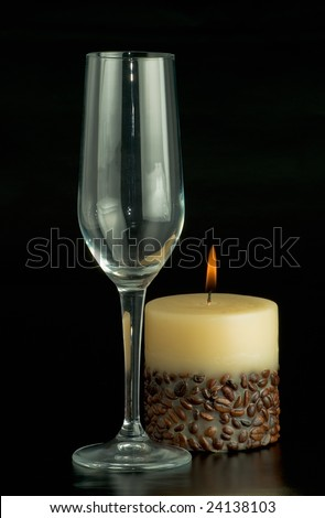 glass and a candle decorated with coffee beans