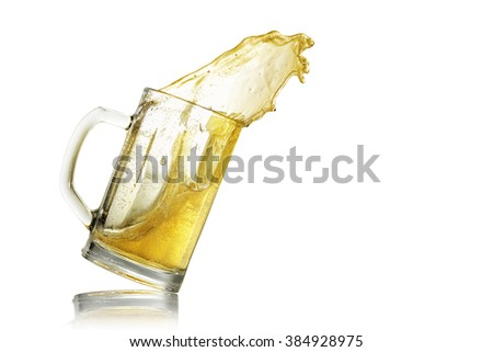 glass and beer splash isolated on white