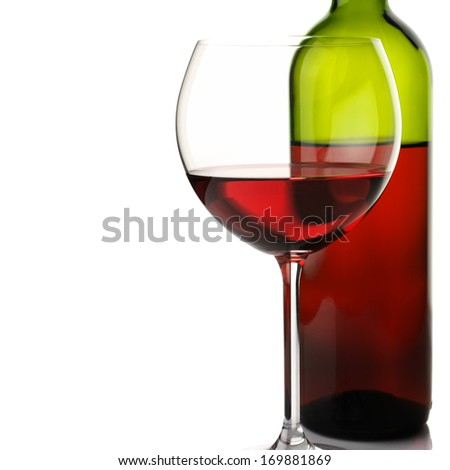 Glass and bottle of red wine on white background. - stock photo