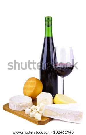 glass and bottle of red wine with different cheese isolated on a white background