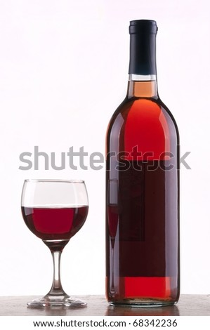 Glass and bottle of rose wine  with  white background - stock photo