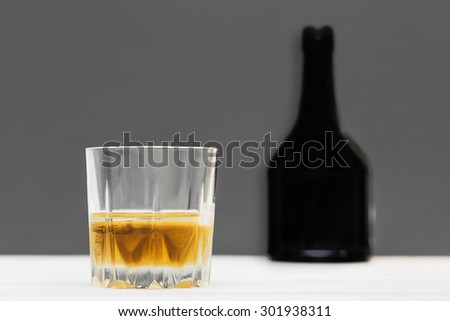glass and bottle of whiskey. strong drink - stock photo