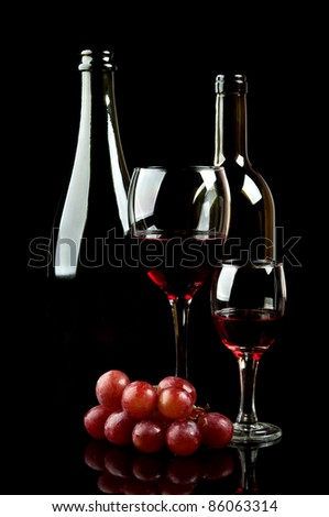 glass and bottle of wine isolated on a black background