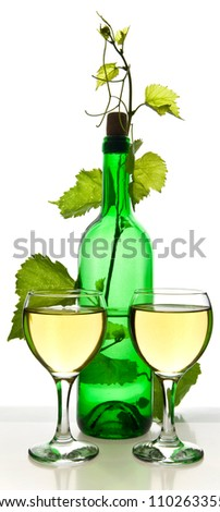 glass and bottle of wine on a white background - stock photo