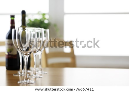 Glass and bottle on the table - stock photo