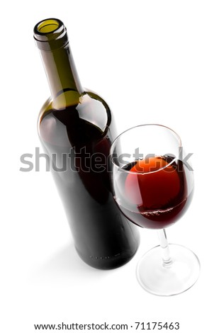 Glass and bottle with red wine on white - stock photo