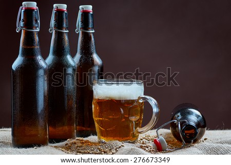 Glass and bottles of beer - stock photo