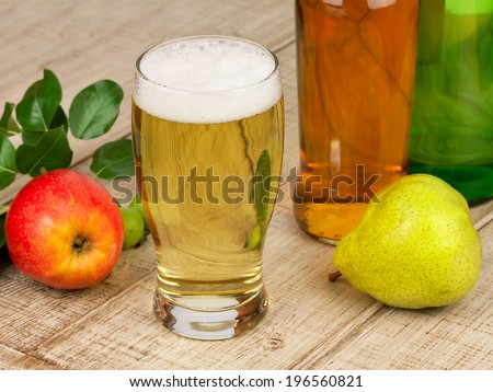 Glass and bottles of cider - stock photo