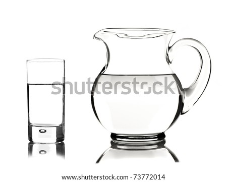 Glass and Glass Pitcher - stock photo