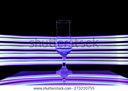glass and light on black background. - stock photo