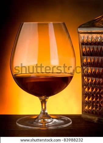 glass and luxury bottle of liquor - stock photo