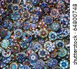 Glass and plastic bright costume jewellery in blue tones, on a street market table. Good for background. - stock photo