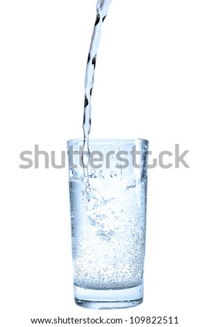 Glass and pouring water. - stock photo