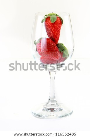 Glass and strawberry isolated on white background
