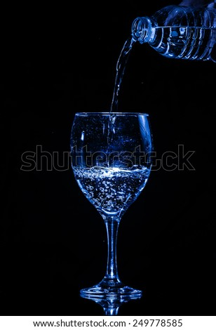 Glass and water - stock photo