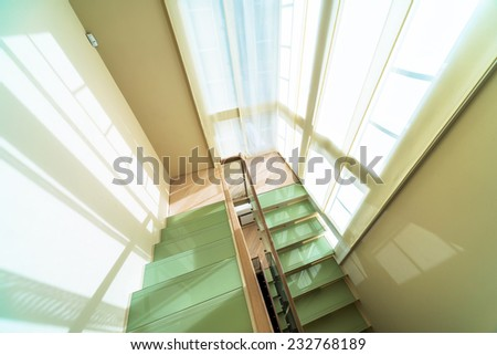 Glass and wooden stairs in modern home interior  - stock photo