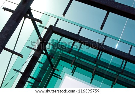 Glass architecture against the clear sky - stock photo