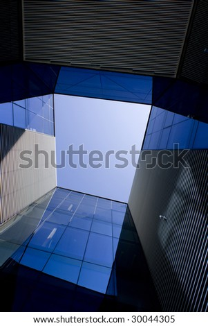 Glass architecture and blue sky - stock photo