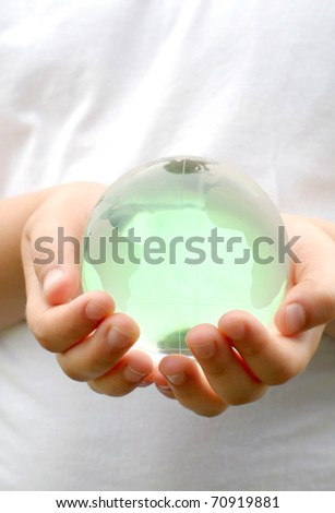 glass ball planet in the hands of children