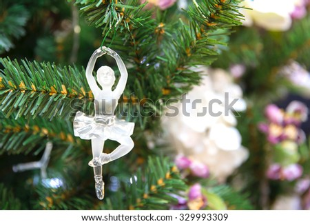 glass ballet dancer on a christmas tree - stock photo
