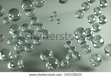 glass balls on a gray matte background - stock photo