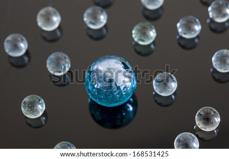 Glass balls on glossy background
