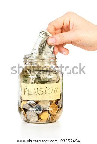 Glass bank for tips with money and hand put dollars for future pension isolated on white - stock photo