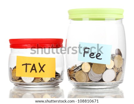 Glass banks for tips with money isolated on white - stock photo