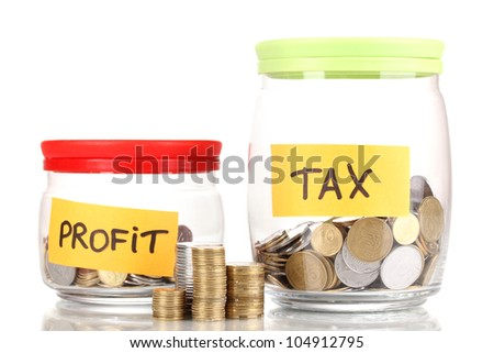Glass banks for tips with money isolated on white. Ukrainian coins - stock photo
